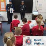 Kent Police officers welcomed by Wingham school children